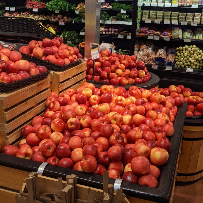 pile of apples in the Franklin store entry produce display
