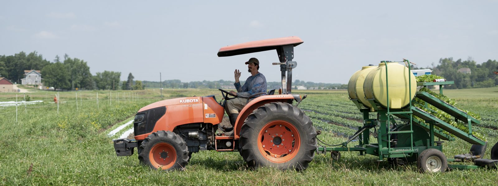 person in a tractor waving