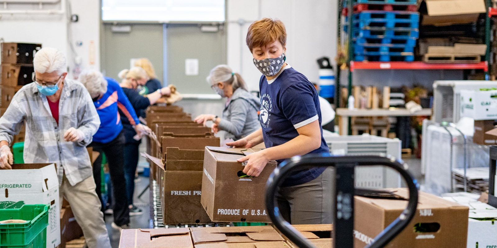 people packing boxes in a warehouse
